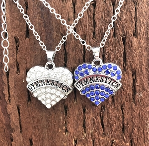 A perfect gift for young gymnasts! These heart-shaped charms feature sparkly rhinestones. Each pendant is suspended from a silver cable chain.