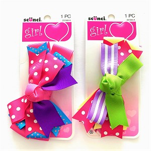 Match any fun outfit with these colorful grosgrain bows from Scunci.