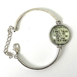 "6 1/2"" to 8"". This adjustable silver bangle is linked by a cabochon charm and fastened with a lobster clasp. Charm caption reads: ""a dance teacher helps her students find the song in their heart."""