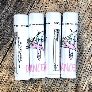 Keep your lips soft and protected with this adorable Miss Unicorn Ballerina chapstick! SPF 15 Made in U.S.A. FDA Compliant and PABA Free. Active Ingredients: Octinoxate: 7.5% (sunscreen), Oxybenzone 3.5% (sunscreen), Petrolatum 42% (skin protectant) Inactive Ingredients: Mineral Oil, Ozokerite, Flavor, Microcrystalline Wax, Lanolin, Copernicia Cerifera (Carnauba Wax), Paraffin, Tocopherol –Vitamin E, Sucralose, Aloe Vera, Methylparaben, Propylparaben. Net Wt. 0.15 oz (4.25g)